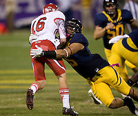 Michael Coley of California tackles Griff McNabb of Utah during the game at AT&T Park in San Francisco, California on October 22, 2011.   California defeated Utah, 34-10.