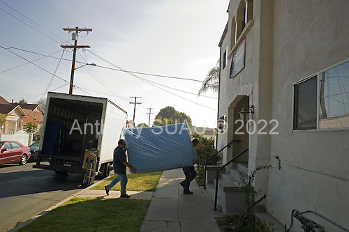 Los Angeles, California<br /> January 29, 2014<br /> <br /> Movers unload donated furniture for the new apartment of WWII (former homeless) veteran Ivan Bennett, 85 who was placed in a VA voucher apartment a few days earlier. His VA case worker William Kurts is present when the furniture arrives.