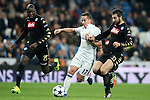 Real Madrid's Lucas Vazquez (c) and SSC Napoli's Kalidou Koulibaly (l) and Raul Albiol during Champions League 2016/2017 Round of 16 1st leg match. February 15,2017. (ALTERPHOTOS/Acero)