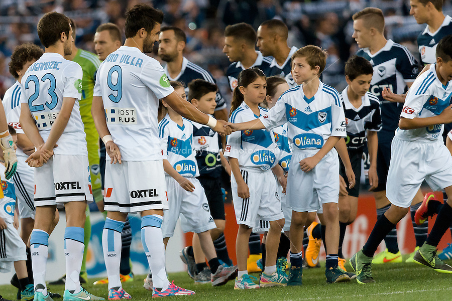 MELBOURNE 25 Oct 2014 – Spanish player David VILLA of Melbourne City shakes hands with his mascot in the round 3 match between Melbourne Victory and Melbourne City in the Australian Hyundai A-League 2014-15 season at Etihad Stadium, Melbourne, Australia.