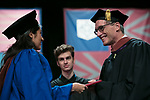 Students receive their degrees from John Culbert, dean of The Theatre School, Saturday, June 10, 2017, during the DePaul University School of Music and The Theatre School commencement ceremony at the Rosemont Theatre in Rosemont, IL. (DePaul University/Jeff Carrion)