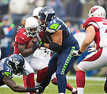Seattle Seahawks Strong Safety Kam Chancellor (31) and defense end Red Bryant (79) wraps up Arizona Cardinals running back Rashard Mendenhall (28) during the first quarter at CenturyLink Field in Seattle, Washington on December 22, 2013.   The Cardinals beat the Seahawks 17-10. ©2013. Jim Bryant Photo. ALL RIGHTS RESERVED.