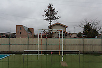 An abandoned school swimming pool inside the Fukushima exclusion zone, Namie, Fukushima, Japan. Wednesday March 9th 2016. The Great East Japan Earthquake on March 11th 2011 was followed by a massive tsunami that levelled much of the Tohoku coast in north east Japan, killing around 18,000 people and causing meltdowns and explosions at the Fukushima Daiichi nuclear power station leading to the contamination and evacuation of a 20 kilometre exclusion zone around the plant.