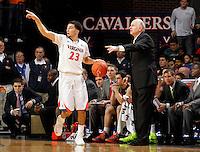 Virginia guard London Perrantes (23) and Miami head coach Jim Larrañaga during an NCAA basketball game Saturday Feb, 24, 2014 in Charlottesville, VA. Virginia defeated Miami 65-40.