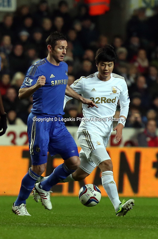 Wednesday 23 January 2013<br /> Pictured L-R: Frank Lampard of Chelsea against Ki Sung Yueng of Swansea <br /> Re: Capital One Cup semi-final second leg, Swansea City FC v Chelsea at the Liberty Stadium, south Wales.