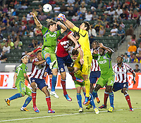CARSON, CA - August 25, 2012: Seattle goalie Michael Gspruning (1) and midfielder Brad Evans (3) during the Chivas USA vs Seattle Sounders match at the Home Depot Center in Carson, California. Final score, Chivas USA 2, Seattle Sounders 6.