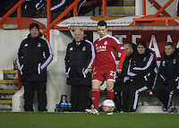 Ryan Jack plays the ball back with a glum Looking Archie Knox (left) and Craig Brown on the left of the player in the Aberdeen v Queen of the South William Hill Scottish Cup 5th Round match played at Pittodrie Stadium, Aberdeen on 4.2.12.