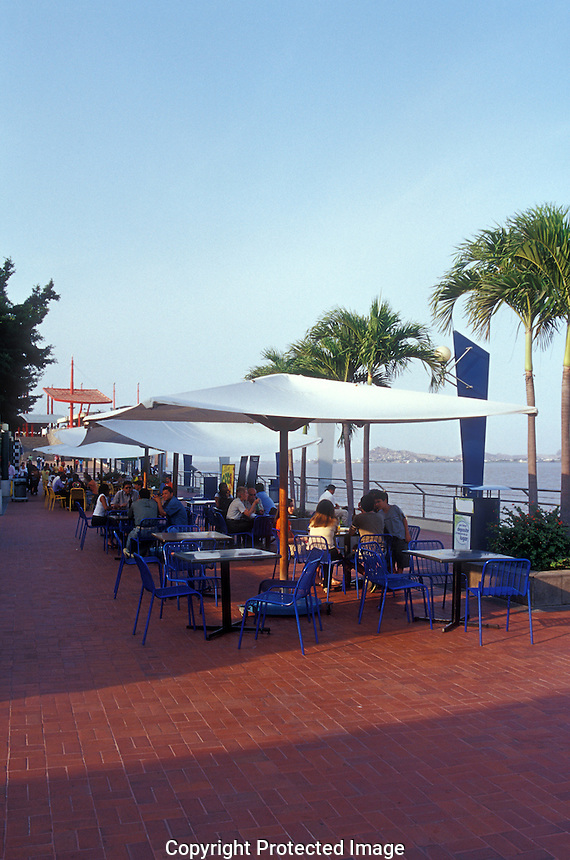 People eating in outdoor restaurants on the Malecon 2000 pedestrian walkway on the restored waterfront area of Guayaquil, Ecuador