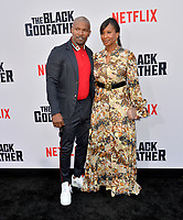 "LOS ANGELES, USA. June 04, 2019: Jamie Foxx & Nicole Avant at the premiere for ""The Black Godfather"" at Paramount Theatre.<br /> Picture: Paul Smith/Featureflash"