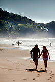 MEXICO, San Pancho, San Francisco, a couple walks hand in hand on San Pancho Beach