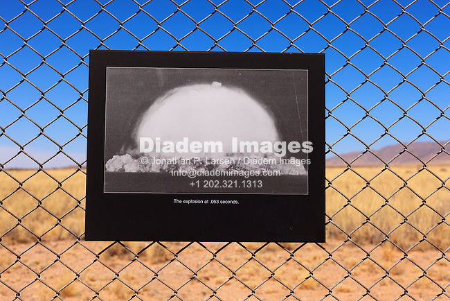 "A photograph at Trinity Site in New Mexico showing the world's first nuclear device being exploded in 1945.  The caption reads:  ""The explosion at .053 seconds."""