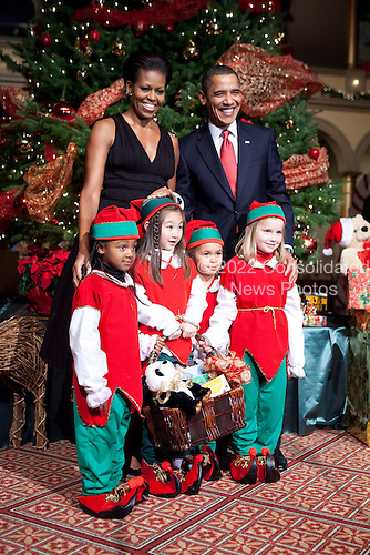 Washington, DC - December 13, 2009 -- United States President Barack Obama and First Lady Michelle Obama pose with children dressed as elves during the Christmas in Washington celebration in Washington, D.C., U.S., Sunday, December 13, 2009. .Credit: Joshua Roberts / Pool via CNP