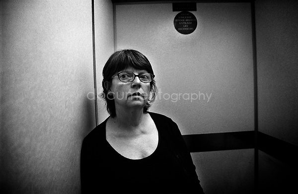 My mother in the lift of the hospital waiting to get to my grandmother's new room and see for the first time a doctor that hopefully will tell us what is happening to my grandmother....© Magali Corouge/Documentography.2004-2006.France