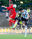 Dundee's Greg Stewart and Hearts' Callum Paterson challenge for the ball.