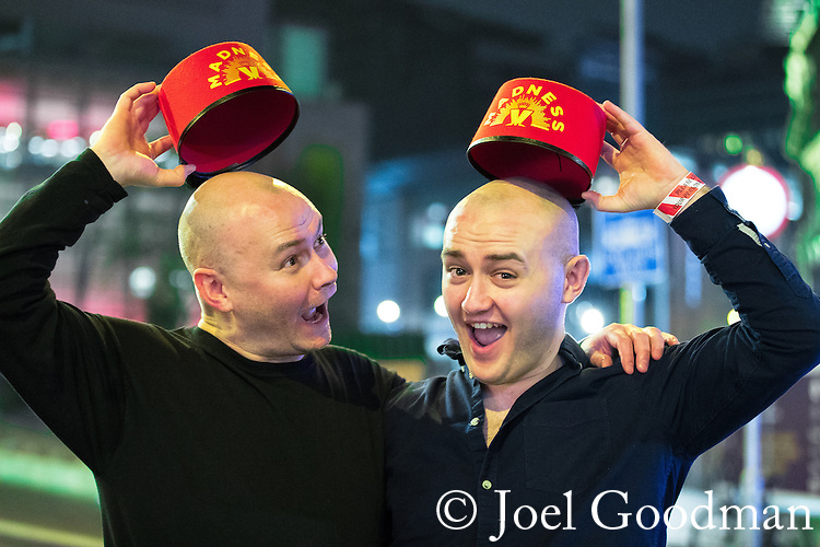 "© Joel Goodman - 07973 332324 . 16/12/2016 . Manchester , UK . Two music fans returning from a Madness gig . Revellers out in Manchester City Centre overnight during "" Mad Friday "" , named for being one of the busiest nights of the year for the emergency services in the UK . Photo credit : Joel Goodman"
