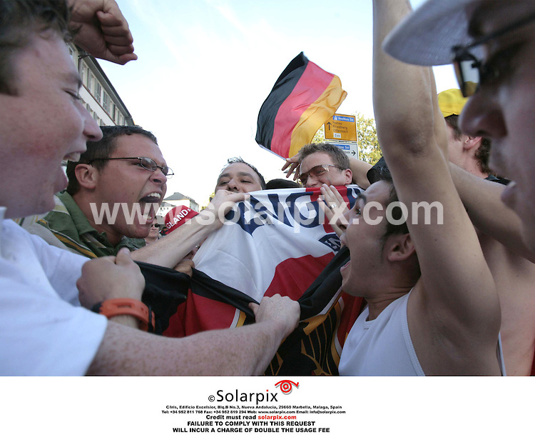 ALL ROUND PICTURES FROM SOLARPIX.COM.*MUST CREDIT SOLARPIX.COM OR DOUBLE FEE WILL BE CHARGED*.**NO PUBLICATION IN FRANCE, SCANDANAVIA, AUSTRALIA AND GERMANY **UK MAGAZINE PUBLICATION ONLY**.England football fans scuffle with German fans in the centre of Frankfurt this evening during  the start of the World Cup 2006...DATE:10.06.06-JOB REF:2476-SFE