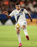 CARSON, CA - SEPTEMBER 21: Diego Polenta #3 of the Los Angeles Galaxy moves with the ball during a game between Montreal Impact and Los Angeles Galaxy at Dignity Health Sports Park on September 21, 2019 in Carson, California.
