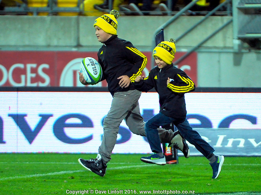 The match ball is carried out for the Super Rugby match between the Hurricanes and Reds at Westpac Stadium, Wellington, New Zealand on Saturday, 14 May 2016. Photo: Dave Lintott / lintottphoto.co.nz