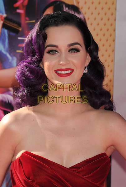 "Katy Perry.arriving at the Los Angeles premiere os ""Katy Perry: Part Of Me"" at Grauman's Chinese Theatre in Hollywood, California, USA, June 26th, 2012..portrait headshot make-up lipstick  strapless red purple dyed hair smiling .CAP/ROT/TM.©TM/Roth Stock/Capital Pictures"