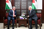 Palestinian president Mahmud Abbas meets with Jordan's King Abdullah II in the West Bank city of Ramallah on August 7, 2017. Jordan's King began a rare visit to the occupied West Bank to meet With Palestinain president, amid shared tensions with Israel over a flashpoint Jerusalem holy site. Photo by Osama Falah