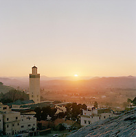 A small town with a mosque and minaret overlooking a valley near Todra Gorge, Morocco