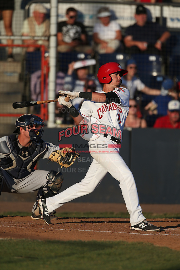 J.C. Cardenas (18) of the Vancouver Canadians bats during a game against the Tri-City Dust Devils at Nat Bailey Stadium on July 23, 2015 in Vancouver, British Columbia. Tri-City defeated Vancouver, 6-4. (Larry Goren/Four Seam Images)