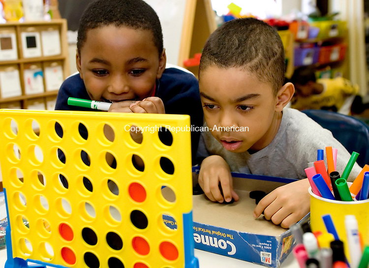 BOSTON, MA- 03 APR 07- 040307JT05- <br /> From left, kindergarteners Nathaniel Lordes and Zaire Fontes-Hewitt play Connect 4 during choice time during their school day at Samuel Mason Elementary School in Roxbury, Mass. on Tuesday, Apr. 3.<br /> Josalee Thrift Republican-American