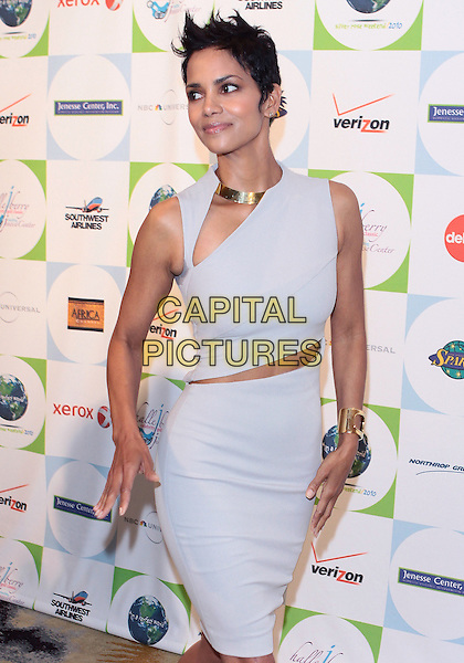 HALLE BERRY.2010 Jenesse Silver Rose  Gala & Auction held at The Beverly Hills Hotel, Beverly Hills, California, USA..April 18th, 2010.half length sleeveless dress skirt top slash gold necklace beige grey gray.CAP/ADM/TC.©T. Conrad/AdMedia/Capital Pictures.