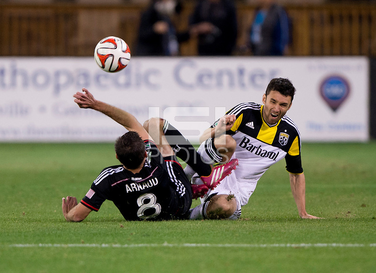 Davy Arnaud (8) of D.C. United collides with Michael Parkhurst (4) of the Columbus Crew during a MLS game at RFK Stadium in Washington, DC.  D.C. United lost to the Columbus Crew, 3-0.