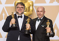 Guillermo del Toro and J. Miles Dale pose backstage with the Oscar&reg; for best motion picture for work on &ldquo;The Shape of Water&rdquo; during the live ABC Telecast of The 90th Oscars&reg; at the Dolby&reg; Theatre in Hollywood, CA on Sunday, March 4, 2018.<br /> *Editorial Use Only*<br /> CAP/PLF/AMPAS<br /> Supplied by Capital Pictures