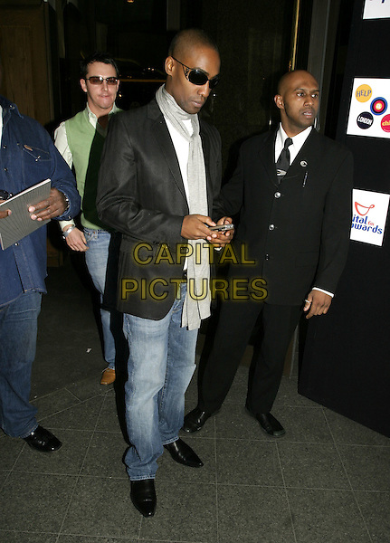 SIMON WEBBE (BLUE).Capital FM Awards 2005, held in aid of Help a London Child, Royal Lancaster hotel, London, March 23rd 2005..full length web webb sunglasses shades dark glasses mobile phone texting? grey scarf.Ref: AH.www.capitalpictures.com.sales@capitalpictures.com.©Adam Houghton/Capital Pictures.