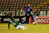 PALMIRA -COLOMBIA-01-03-2015. German Mera (Izq) jugador del Deportivo Cali disputa un balón con Fernando Uribe (Der) jugador del Millonarios durante partido por la fecha 7 de la Liga Aguila I 2015 jugado en el estadio Palmaseca de la ciudad de Palmira./  German Mera (L) player of Deportivo Cali fights the ball with Fernando Uribe (R) player of Millonarios during match for the 7th date of Aguila League I 2015 played at Palmaseca stadium in Palmira city Photo: VizzorImage/ Juan C. Quintero /STR