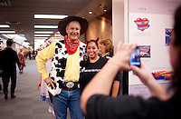 Southwest Airlines Chief Executive Officer and President Gary Kelly (cq), dressed as Woody from Toy Story, poses for a photo with an employee during the Southwest Airlines annual Halloween festivities at the headquarters building near Love Field Airport in Dallas, Texas, Friday, October 29, 2010...PHOTO/ MATT NAGER