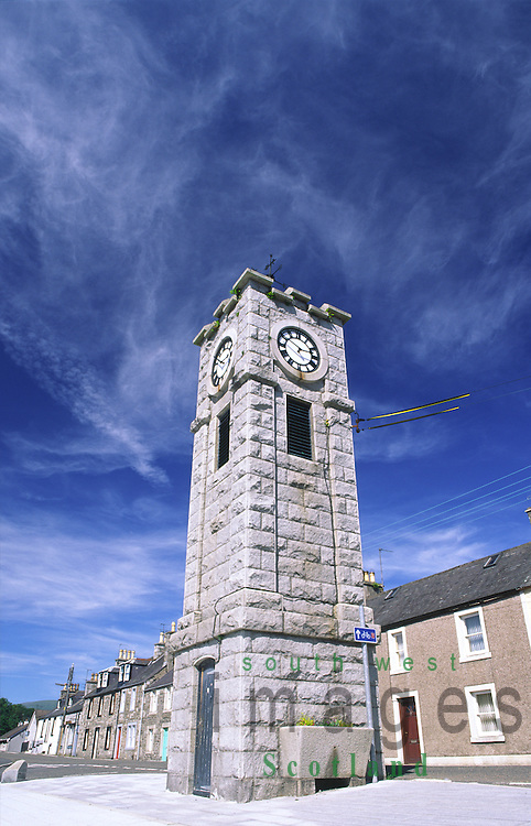 Creetown the clock tower in the centre of the village and granite sculpture by Hideo Foruta, local artists, on the edge of Luce Bay Dumfries and Galloway Scotland UK