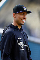 Carlos Gonzalez #5 of the Colorado Rockies before a game against the Los Angeles Dodgers at Dodger Stadium on April 30, 2013 in Los Angeles, California. (Larry Goren/Four Seam Images)