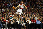04/03/11--Blazers' Rudy Fernandez saves the ball from going out of bounds and then passes the ball to teammate Gerald Wallace against the Dallas Mavericks a the Rose Garden in Portland, Or.. Portland defeated Dallas 104-96..Photo by Jaime Valdez........................................