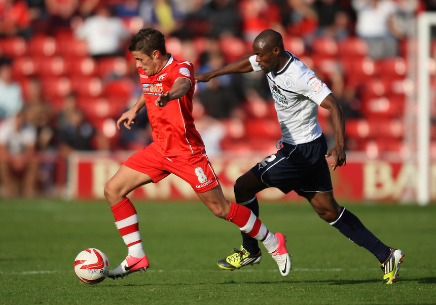 Preston North End's Akpo Sodje battles with Flo Cuvelier..Football - npower Football League Division One - Walsall v Preston North End - Saturday 22nd September 2012 - Banks's Stadium - Walsall..