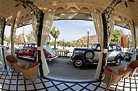 Waiting pavilion of the Taj Lake Palace with classic vintage cars parked. (Photo by Matt Considine - Images of Asia Collection)