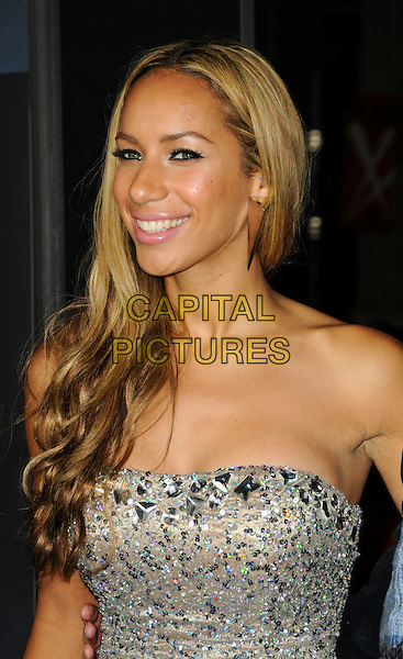 "LEONA LEWIS.The Los Angeles premiere of ""Avatar"" at Grauman's Chinese Theatre in Hollywood, California, USA..December 16th, 2009.headshot portrait silver strapless beige beaded sparkly jewel encrusted embellished eyeliner pink lipstick mirror earrings triangle half length.CAP/ROT.©Lee Roth/Capital Pictures"