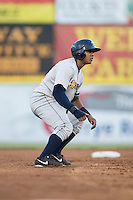 Isaias Tejeda (19) of the Charleston RiverDogs takes his lead off of second base against the Hickory Crawdads at L.P. Frans Stadium on August 25, 2015 in Hickory, North Carolina.  The Crawdads defeated the RiverDogs 7-4.  (Brian Westerholt/Four Seam Images)