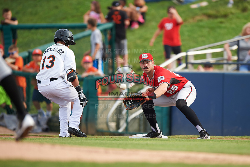 Carolina Mudcats first baseman Sal Giardina (25) waits for a throw as Jay Gonzalez (13) gets back to the bag during a game against the Frederick Keys on June 4, 2016 at Nymeo Field at Harry Grove Stadium in Frederick, Maryland.  Frederick defeated Carolina 5-4 in eleven innings.  (Mike Janes/Four Seam Images)