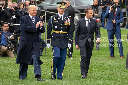 United States President Donald J. Trump and French President Emmanuel Macron participate in a military review <br /> on the South Lawn of the White House during the French State Visit to the United States on April 24, 2018 in Washington, DC. Credit: Alex Edelman / Pool via CNP