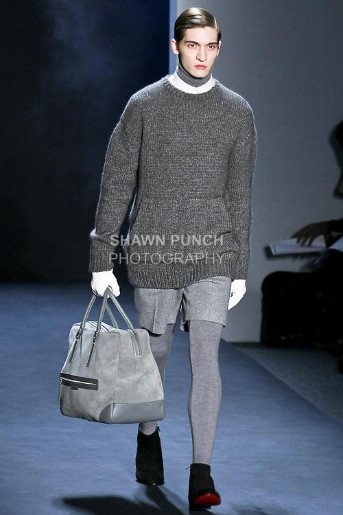 Matvey Lykov walks the runway in a Davidelfin Fall Winter 2010-2011 outfit by Spanish designer David Delfin, during Mercedes-Benz Fashion Week Fall 2010.