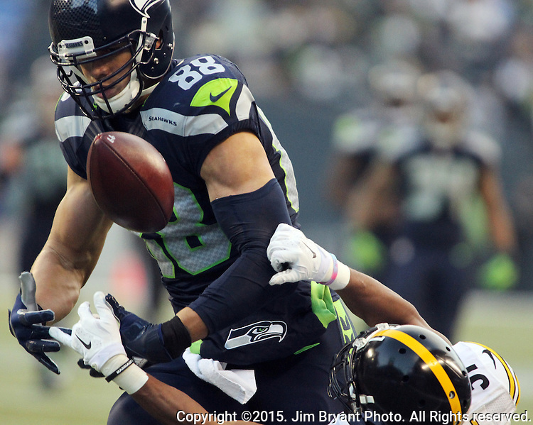 Seattle Seahawks tight end Jimmy Graham catches a pass while being defended by Pittsburgh Steelers cornerback Ross Cockrell (31) at CenturyLink Field in Seattle, Washington on November 29, 2015.  The Seahawks beat the Steelers 39-30.      ©2015. Jim Bryant Photo. All Rights Reserved.