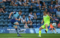 Dayle Southwell of Wycombe Wanderers clears the ball past Tom Lapslie of Colchester United during the Sky Bet League 2 match between Wycombe Wanderers and Colchester United at Adams Park, High Wycombe, England on 27 August 2016. Photo by Andy Rowland.