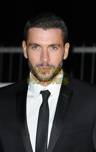 SHAYNE WARD .Collars and Coats Gala marking Battersea Dogs & Cats Home's 150th Anniversary at Battersea Power Station, Battersea, London, England, UK, November 25th 2010..portrait headshot black tie white shirt beard facial hair .CAP/WIZ.© Wizard/Capital Pictures.