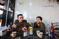 KURDISTAN, NORTHERN IRAQ, Dokuk.<br /> Qalubna Ma'Kum Feature:<br /> Qalubna Ma'kum (meaning &quot;Our hearts are With You&quot;) are a group of foreign volunteer fighters who have joined up with the Peshmerga in Kurdistan to help with the battle against Daesh, also known as ISIS. <br /> <br /> Pictured: Exhausted co-founders Francis Cuvelier (left) and Kat Argo (right) in a cafe during a trip to Erbil City centre, two hours drive from the base.