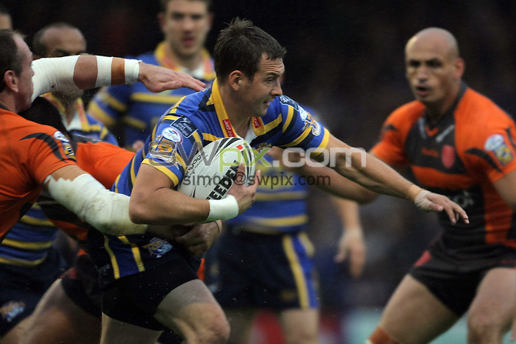 PICTURE BY VAUGHN RIDLEY/SWPIX.COM - Rugby League - Super League - Leeds v Hull KR - Headingley, Leeds, England  - 17/07/09...Copyright - Simon Wilkinson - 07811267706...Leeds Danny McGuire drives forward in the rain.