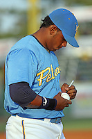 Geraldo Avila #49 of the Myrtle Beach Pelicans signing an autograph on the field before a game against the Frederick Keys on May 1, 2010 in Myrtle Beach, SC.