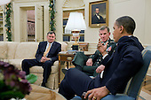 Washington, DC - December 7, 2009 -- United States President Barack Obama meets with United States Ambassador to Afghanistan Karl Eikenberry, left, and General Stanley McChrystal, Commander, International Security Assistance Force, in the Oval Office, Monday, December 7, 2009. .Mandatory Credit: Pete Souza - White House via CNP